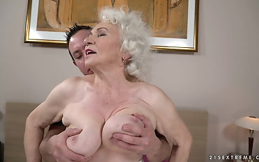 Demands the tits of granny Norma while drilling her pussy