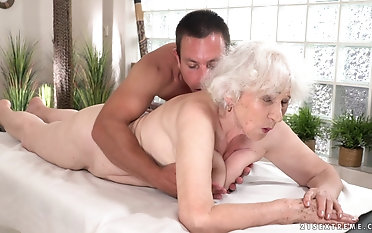 Naughty granny Norma gets her pussy fucked by a young blarney