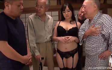 Nonami Shizuka pleases two older guys unconnected with sucking their cocks