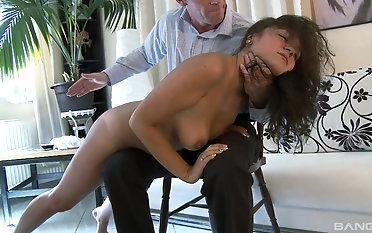 Brunette Donna Ray gets her round ass spanked by a kinky friend