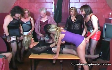 Older crossdressers with team a few attractive  females